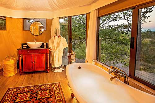 The Elephant Camp West - safari lodge bathroom