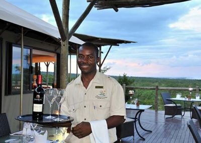 Waiter serving at The Elephant Camp safari lodge